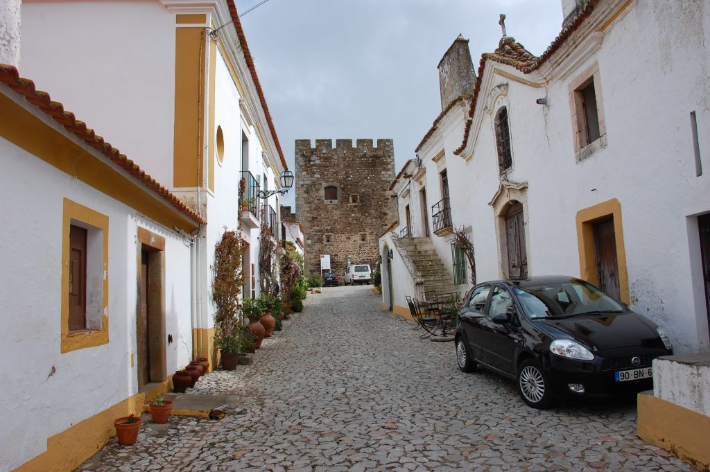 The castelo in Terena (background).  Casa de Terena is on the left; that is our rental car on the right.