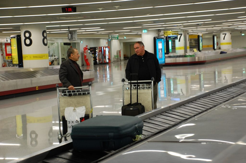 Waiting for our luggage with two of our travelling companions.