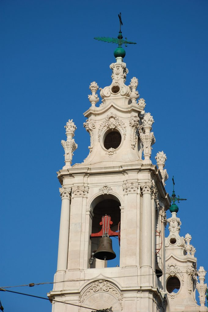 Part of the Basilica da Estrela against the beautiful blue Lisboan sky.