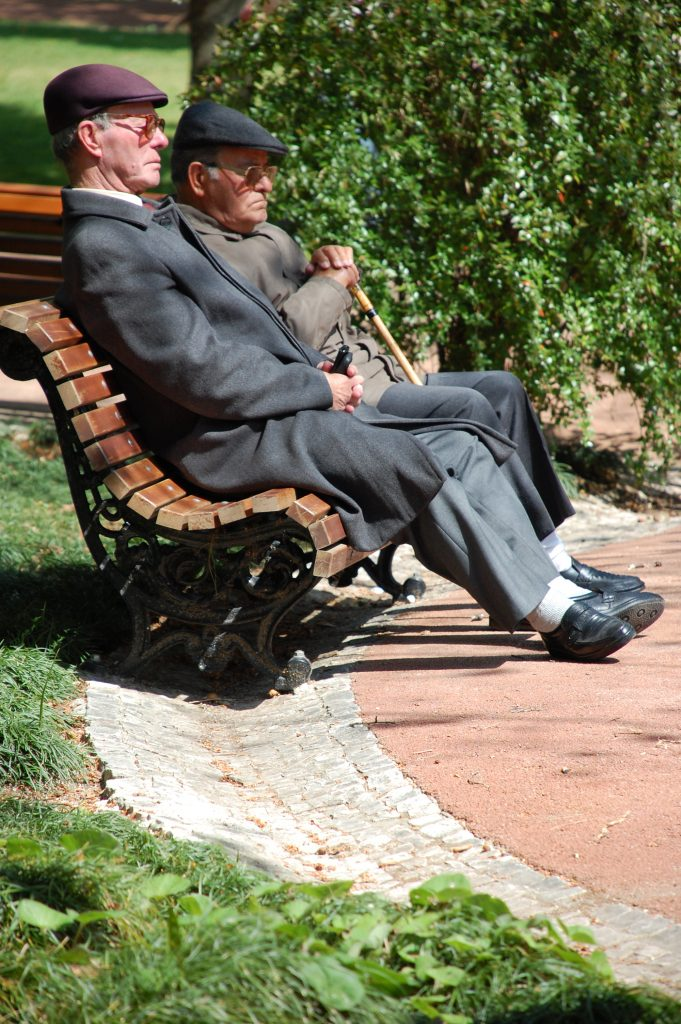 Old friends taking the sun in Jardim da Estrela.