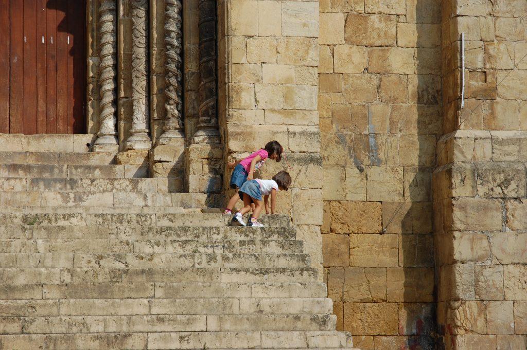 Exploring limits on the steps of the Igreja de São Tiago.