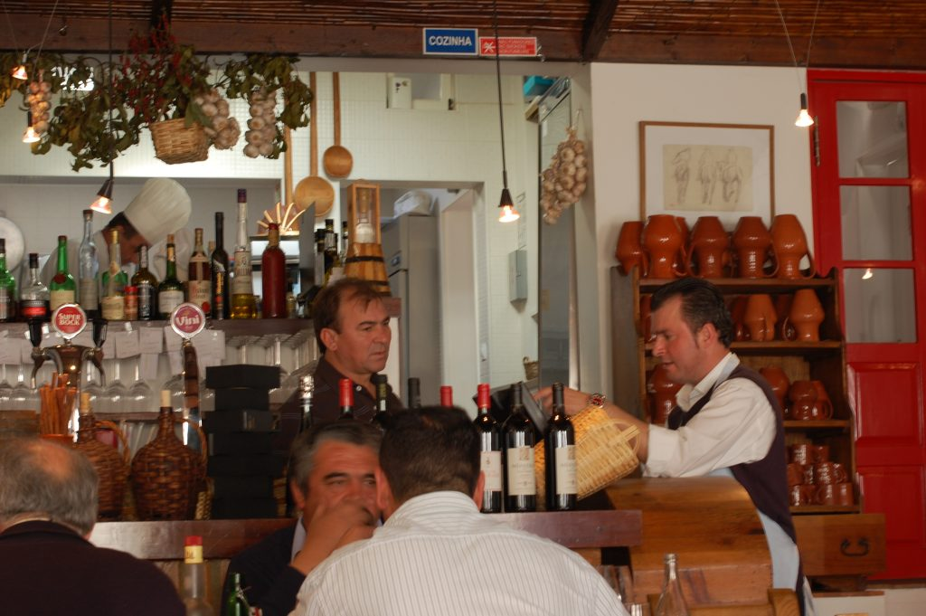 The owner and the waiter at Tasca do Celso (they are the two standing).  You will note that the owner looks quite a lot like Tommy Lee Jones, the actor!