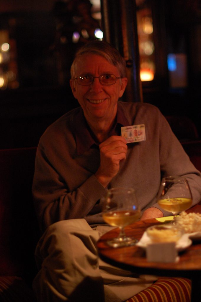 Steve shows his Portuguese ID (Viva transit card) while enjoying a young Scotch at Bar Procópio.
