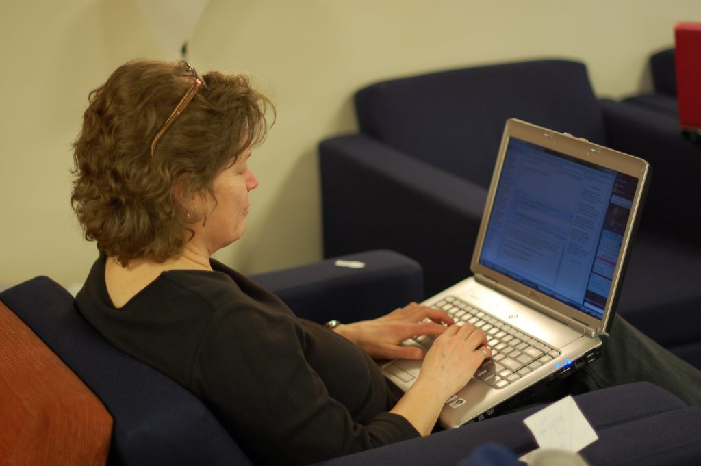 Susan catches up on some last-minute correspondence in  the wonderful KLM  Lounge at  Pearson Airport while  we wait for our flight to Portugal.